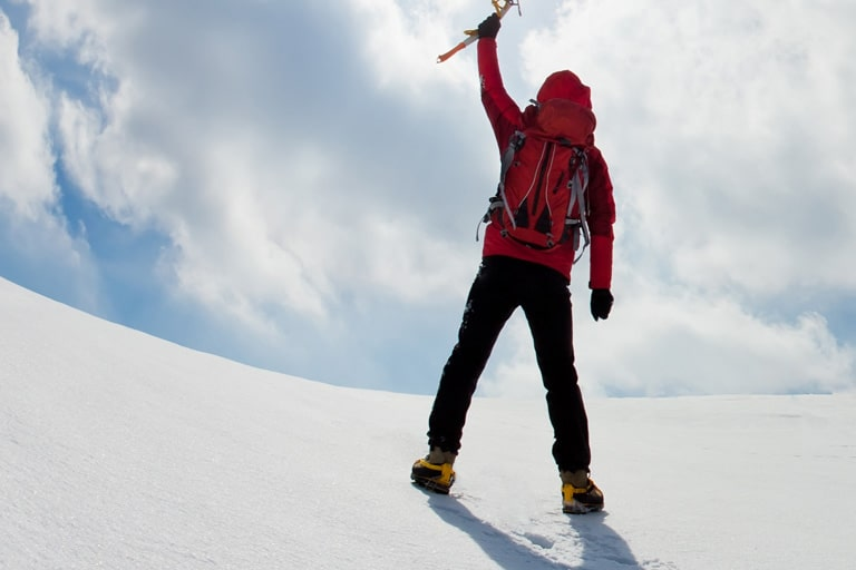 mountaineer-walking-uphill-along-a-snowy-slope3-1.jpg