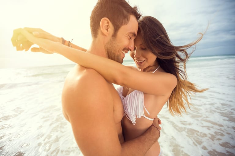 young-happy-couple-with-draw-heart-on-tropical1.jpg